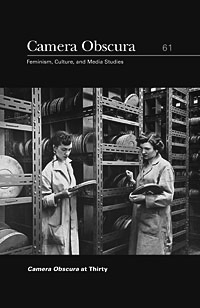 Cover of 'Camera Obscura' journal #61, depitcing two women inspecting celluloid film cans in a film archive.